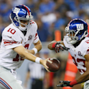 New York Giants quarterback Eli Manning hands off to running back Rashad Jennings during the first quarter of an NFL football game against the Detroit Lions in Detroit, Monday, Sept. 8, 2014 The Associated Press
