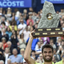 Pablo Andujar of Spain, celebrates with the trophy after he won the final match against Juan Monaco of Argentina at the Swiss Open tennis tournament in Gstaad, Switzerland, Sunday, July 27, 2014. (AP Photo/Keystone,Peter Schneider)