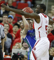 North Carolina State's Desmond Lee (5) pressures Florida Gulf Coast's Brett Comer (0) during the first half of an NCAA college basketball game at PNC Arena in Raleigh, N.C., Tuesday, Nov. 26, 2013. (AP Photo/The News & Observer, Ethan Hyman)