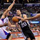 San Antonio Spurs guard Manu Ginobili (20), of Argentina, drives on Los Angeles Clippers forward Blake Griffin. left center, center DeAndre Jordan, left, and forward Jared Dudle, right, as he goes to the basket in the first half of a NBA basketball game,