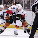 Anaheim Ducks' Hampus Lindholm, back, defends Calgary Flames' TJ Brodie during an NHL hockey game Tuesday, Nov. 25, 2014, in Anaheim, Calif The Associated Press