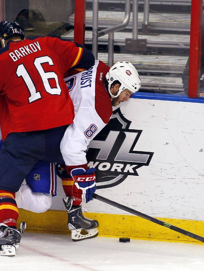 Florida Panthers center Aleksander Barkov (16) checks Montreal Canadiens right wing Brandon Prust (8) during the second period of an NHL hockey game in Sunrise, Fla., on Sunday, Dec. 29, 2013. Florida won 4-1
