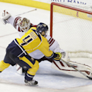 Nashville Predators defenseman Ryan Ellis (4) scores against Arizona Coyotes goalie Devan Dubnyk during a shootout at an NHL hockey game Tuesday, Oct. 21, 2014, in Nashville, Tenn. The Predators won the shootout to win the game 4-3 The Associated Press