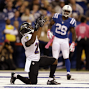 Baltimore Ravens running back Justin Forsett, left, celebrates a touchdown in front of Indianapolis Colts strong safety Mike Adams during the second half of an NFL football game in Indianapolis, Sunday, Oct. 5, 2014 The Associated Press