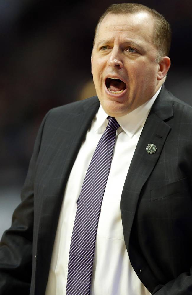 Chicago Bulls coach Tom Thibodeau talks to his players during the first half of an NBA basketball game against the Milwaukee Bucks in Chicago, Friday, April 4, 2014