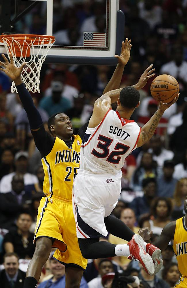 Atlanta Hawks forward Mike Scott (32) drives against Indiana Pacers center Ian Mahinmi (28) in the first half of Game 4 of an NBA basketball first-round playoff series, Saturday, April 26, 2014, in Atlanta