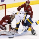 As Arizona Coyotes' Mike Smith (41) makes a save on a shot, Nashville Predators' Matt Cullen (7) gets checked by Coyotes' Oliver Ekman-Larsson (23), of Sweden, during the third period of an NHL hockey game Thursday, Dec. 11, 2014, in Glendale, Ariz. The