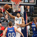 CHARLOTTE, NC - APRIL 3: Gerald Henderson #9 of the Charlotte Bobcats goes up for reverse dunk against Damien Wilkins #8 of the Philadelphia 76ers at the Time Warner Cable Arena on April 3, 2013 in Charlotte, North Carolina. (Photo by Kent Smith/NBAE via Getty Images)