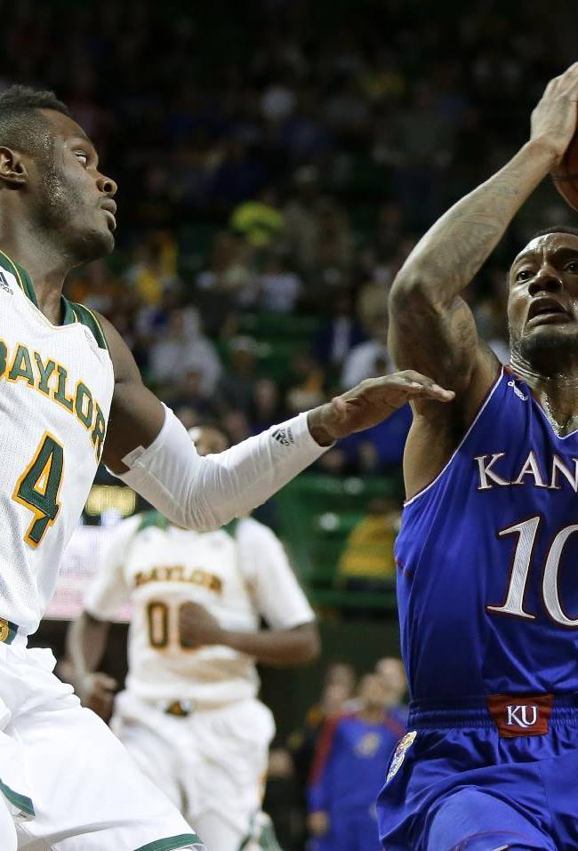 Baylor's Gary Franklin (4) defends as Kansas' Naadir Tharpe (10) drives to the basket for a shot attempt in the first half of an NCAA college basketball game, Tuesday, Feb. 4, 2014, in Waco, Texas