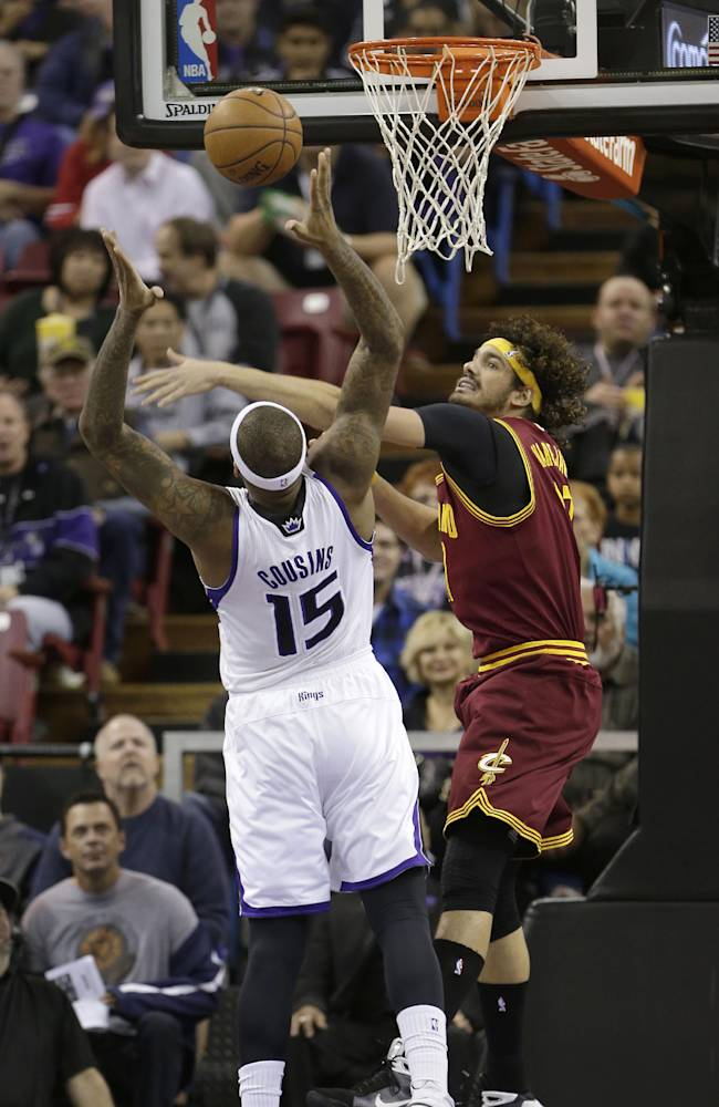 Cleveland Cavaliers center Anderson Varejao, right, of Brazil, tries to block the shot of Sacramento Kings center DeMarcus Cousins during the first quarter of an NBA basketball game in Sacramento, Calif.,  Sunday, Jan. 12, 2014