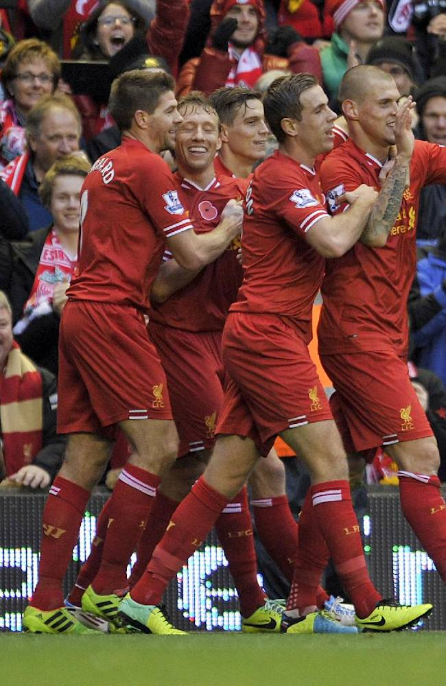 Liverpool's Martin Skrtel right, celebrates after he scored the first goal of the game for his side during their English Premier League soccer match against Fulham at Anfield in Liverpool, England, Saturday, Nov. 9, 2013