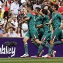 Mexico's Oribe Peralta (9) celebrates his goal with teammates including Marco Fabian (8)and Darvin Chavez (5) during the men's soccer final against Brazil at the 2012 Summer Olympics, Saturday, Aug. 11, 2012, in London. (AP Photo/Hassan Ammar)