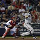 Minnesota Twins designated hitter Ryan Doumit (9) follows through with an RBI base hit as Atlanta Braves catcher Brian McCann (16) watches in the eighth inning of a baseball game Tuesday, May 21, 2013 in Atlanta. (AP Photo/John Bazemore)