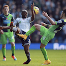 West Bromwich Albion's Youssof Mulumbu is challenged by Newcastle United's Remy Cabella, right, during their English Premier League soccer match at the Hawthorns, West Bromwich, England, Sunday Nov. 9, 2014. (AP Photo / David Davies, PA)