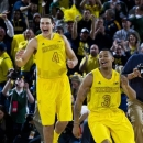 Michigan guard Trey Burke (3) and forward Mitch McGary (4) celebrate at the end of an NCAA college basketball game with Michigan State, Sunday, March 3, 2013, at Crisler Center in Ann Arbor, Mich. Michigan won 58-57. (AP Photo/Tony Ding)
