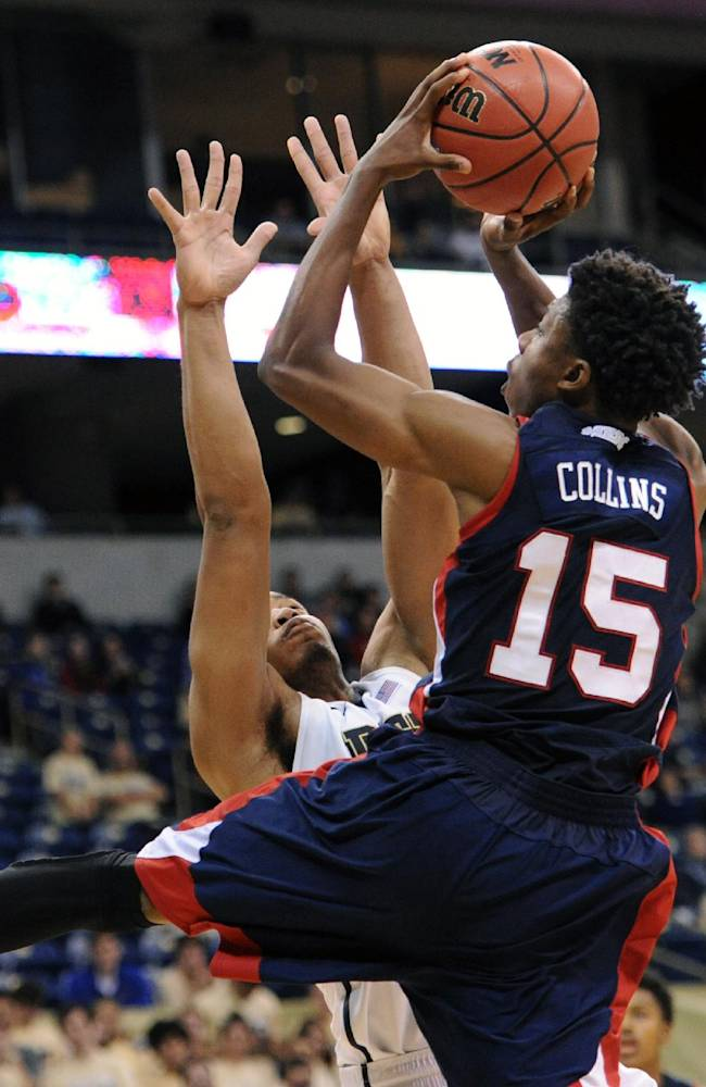 Pittsburgh's Jamel Artis tries to block a shot by Howard's Damon Collins, right, in the second half of an NCAA college basketball game on Sunday, Nov. 17, 2013, in Pittsburgh