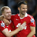 This is a Monday, Aug. 16, 2010 file photo Manchester United's Ryan Giggs, right, with teammate Paul Scholes after scoring a goal against Newcastle United during their English Premier League soccer match at Old Trafford, Manchester, England. Ryan Giggs