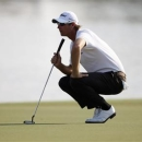 Nicolas Colsaerts of Belgium lines up his shot on the 18th green during the first round of the DP World Tour Championship at Jumeirah Golf Estates in Dubai, November 22, 2012. REUTERS/Nikhil Monteiro
