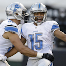 Detroit Lions wide receiver Golden Tate (15) celebrates after scoring on a 28-yard touchdown reception, with tight end Joseph Fauria during the first quarter of an NFL preseason football game against the Oakland Raiders in Oakland, Calif., Friday, Aug. 15