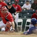 Texas Rangers' Robinson Chirinos (61) slides safely past Los Angeles Angels catcher Chris Iannetta during the fourth inning of an exhibition spring training baseball game Tuesday, March 4, 2014, in Tempe, Ariz. Chirinos scored from first on a hit by Leony