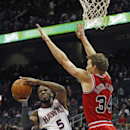 Atlanta Hawks small forward DeMarre Carroll (5) passes as Chicago Bulls small forward Mike Dunleavy (34) defends in the first half of an NBA basketball game Tuesday, Feb. 25, 2014, in Atlanta The Associated Press