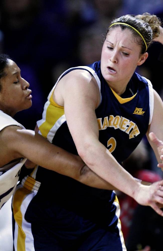 Kansas State guard Twiggy McIntyre, left, attempts to steal the ball away from Marquette guard Carolyn Kieger during the first half of the WNIT championship basketball game Friday, March 31, 2006, in Manhattan, Kan