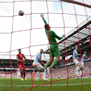 Liverpool's Martin Skrtel, right, scores past Manchester City's goalkeeper Joe Hart, centre right, during their English Premier League soccer match at Anfield Stadium, Liverpool, England, Sunday April 13, 2014