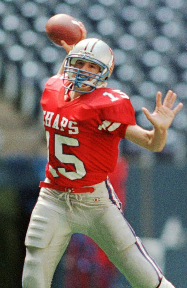 In this Dec. 21, 1996 file photo, Westlake High School quarterback Drew Brees prepares to pass against Abilene Cooper High School during a football game in Austin, Texas. Ten years after Brees led Westlake High School to victory in the Texas state championship game, Nick Foles broke several of his passing records but lost in the title game. The two quarterbacks meet with far more at stake _ Saints vs. Eagles in an NFC wild-card game