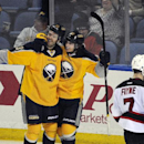 Buffalo Sabres' Ville Leino, left, and Tyler Ennis, right, celebrate a goal by Ennis as New Jersey Devils' Mark Fayne (7), reacts during the third period of an NHL hockey game in Buffalo, N.Y., Tuesday, April 1, 2014. Buffalo won 3-2 in the team shootou