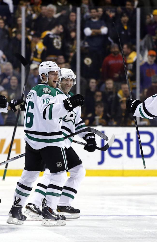 Dallas Stars center Rich Peverley (17) is greeted by teammates after his shootout goal gave the Stars a 3-2 win over the Boston Bruins in an NHL hockey game in Boston on Tuesday, Nov. 5, 2013