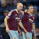 West Ham United's James Collins, left, celebrates with teammate Mark Noble after scoring against Everton during their English FA Cup third round soccer match at Goodison Park Stadium, Liverpool, England, Tuesday Jan. 6, 2015