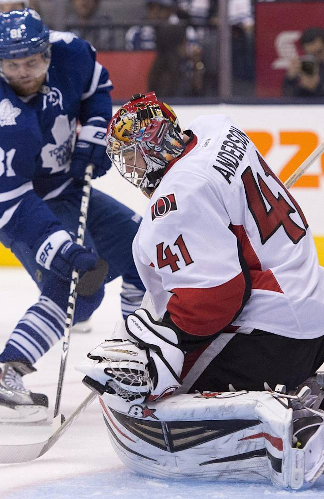 Ottawa Senators goaltender Craig Anderson (41) makes a save against Toronto Maple Leafs' Phil Kessel (81) during second-period NHL hockey game action in Toronto, Saturday, Oct. 5, 2013
