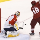 Florida Panthers' Roberto Luongo (1) makes a save on a shot by Arizona Coyotes' Shane Doan (19) during the second period of an NHL hockey game Saturday, Oct. 25, 2014, in Glendale, Ariz The Associated Press