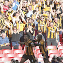 Hull City's Tom Huddlestone, left, celebrates his goal against Sheffield United with teammates and the crowd during their English FA Cup semifinal soccer match at Wembley Stadium in London, Sunday, April 13, 2014
