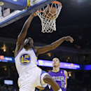 Golden State Warriors guard Jordan Crawford (55) dunks past Sacramento Kings' Jared Cunningham (9) during the second half of an NBA basketball game Friday, April 4, 2014, in Oakland, Calif The Associated Press