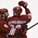 Arizona Coyotes' Oliver Ekman-Larsson, right, of Sweden, celebrates his game-winning goal against the Edmonton Oilers with teammate Sam Gagner (9) during overtime of an NHL hockey game Tuesday, Dec. 16, 2014, in Glendale, Ariz. The Coyotes defeated the Oi