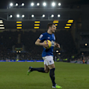 Everton's Leighton Baines runs to take a corner during the English Premier League soccer match between Everton and West Bromwich Albion at Goodison Park Stadium, Liverpool, England, Monday Jan. 19, 2015