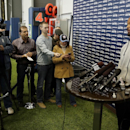 Seattle Seahawks defensive end Michael Bennett, right, talks to reporters, Monday, March 10, 2014, at the team's headquarters in Renton, Wash. The Seahawks announced Monday that Bennett, who was one of the top NFL football free agents this year, had signe