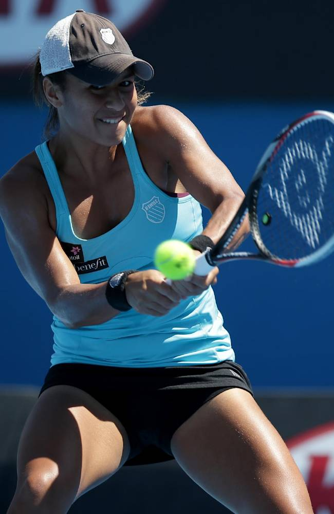 Heather Watson of Britain makes a backhand return to Daniela Hantuchova of Slovakia during their first round match at the Australian Open tennis championship in Melbourne, Australia, Monday, Jan. 13, 2014