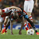 Arsenal's Jack Wilshere, left, vies for the ball with Besiktas' Atiba Hutchinson during a second leg Champions League qualifying soccer match between Arsenal and Besiktas at Emirates Stadium in London Wednesday, Aug. 27, 2014