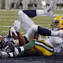 St. Louis Rams tight end Lance Kendricks, left, lands in the end zone after catching an 11-yard touchdown pass as Green Bay Packers cornerback Micah Hyde defends during the second quarter of a preseason NFL football game Saturday, Aug. 16, 2014, in St. Lo