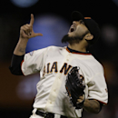 San Francisco Giants' Sergio Romo celebrates after the final out is made against the San Diego Padres at the end of a baseball game Tuesday, June 18, 2013, in San Francisco. The Giants won the game, 5-4. (AP Photo/Ben Margot)