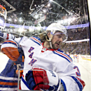 New York Rangers' Mats Zuccarello (36) is checked into the glass Edmonton Oilers' Andrew Ference (21) during first period NHL hockey action in Edmonton, Alberta, on Sunday, Dec. 14, 2014 The Associated Press