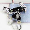Pittsburgh Penguins' Marc-Andre Fleury (29) covers a loose puck before Chicago Blackhawks' Kris Versteeg (23) can get his stick on it during the second period of an NHL hockey game in Pittsburgh, Sunday, March 30, 2014. The Penguins won 4-1 The Associated