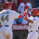 Los Angeles Angels&#039; Alberto Callaspo (6) is greeted at home plate by Mark Trumbo (44) and Howie Kendrick after Callaspo hit a three-run home run in the seventh inning against the Chicago White Sox during a baseball game, Saturday, May 18, 2013, in Anaheim, Calif. (AP Photo/Mark J. Terrill)