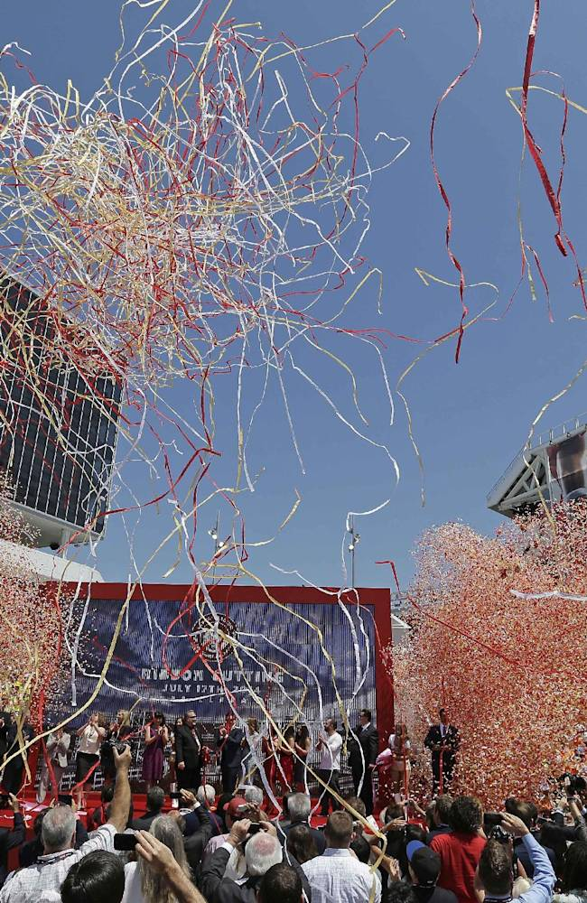 In this July 17, 2014, file photo, confetti rains down during the ribbon-cutting and opening of Levi's Stadium in Santa Clara, Calif. The 49ers prepare for their first preseason game at new Levi's Stadium on Sunday when they host the Denver Broncos