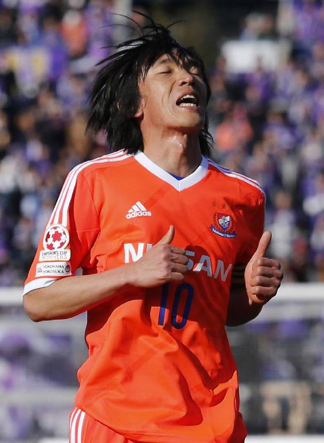 Yokohama F Marinos' Shunsuke Nakamura reacts after failing to score a goal against Sanfrecce Hiroshima in the Super Cup soccer match in Tokyo, Saturday, Feb. 22, 2014. Sanfrecce won the match, 2-0
