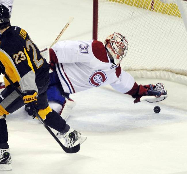 Buffalo Sabres' Ville Leino (23) skates by as Montreal Canadiens' Carey Price (30) dives backward to save a goal during the third period of an NHL hockey game in Buffalo, N.Y., Wednesday, Nov. 27, 2013. Montreal won 3-1