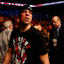 Nate Diaz exits the Octagon following his decision loss to Rafael dos Anjos. (Getty)