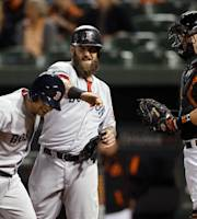 Boston Red Sox's Mike Napoli, center, celebrates with Daniel Nava in front of Baltimore Orioles catcher Matt Wieters after Nava's three-run home run in the first inning of a baseball game, Friday, Sept. 27, 2013, in Baltimore. (AP Photo/Patrick Semansky)